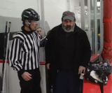 Out of his wheelchair, Dimitrie Vincent walks into the bench area where is longtime friend and fellow priest, the Rev. Andrew Yavornitzky, of St. Mark Orthodox Church in Rochester Hills gave a blessing before the start of each game.